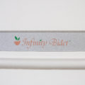 Clear Water Bidets, Infinity Bidet label on bidet seat